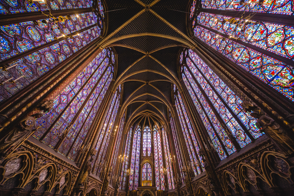 Brilliant panels of stained glass windows to ceiling separated by ornate gold columns. Do not miss on your 4 days in Paris itinerary.