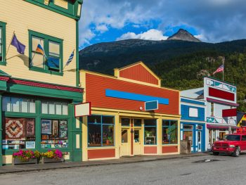 vintage buildings very colorful with mountains in background