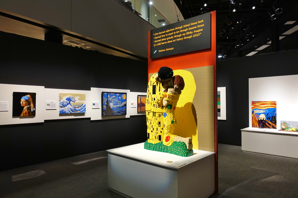 A view of the Carnegie Art Museum during a Lego exhibit. There are Lego sculptures made to look like classic paintings like 'Starry Night', 'Girl With A Pearl Earring', and 'The Kiss'.