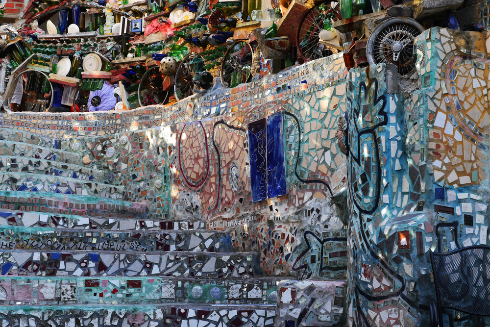 A mosaic wall and stairwell in the Philadelphia Magic Gardens. The mosaic is very elaborate and on top of the mosaic wall is another wall made entirely of found objects. Its one of the best things to do in Philadelphia.